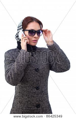 Fashion young woman speaks by phone. All isolated on white background.
