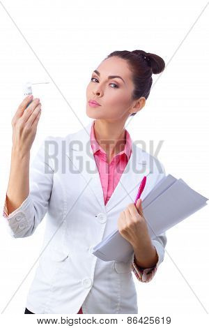 Confident, serious doctor holding chart and medicine.