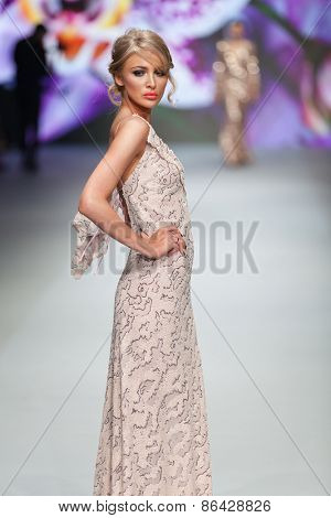ZAGREB, CROATIA - MARCH 21, 2015: Fashion model wearing clothes designed by Ivica Skoko on the 'Fashion.hr' fashion show