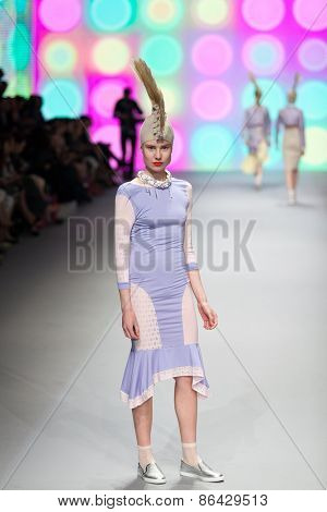 ZAGREB, CROATIA - MARCH 21, 2015: Fashion model wearing clothes designed by 'BiteMyStyle by Zoran Aragovi?' on the 'Fashion.hr' fashion show