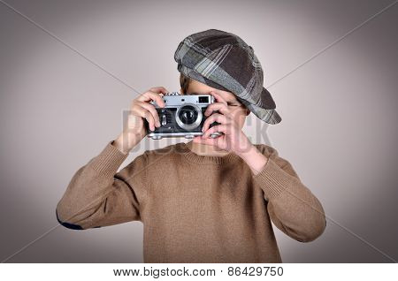 Young boy with retro camera