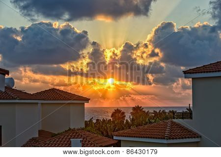 Sunset Over Holiday Beach Villas On Cyprus Coast