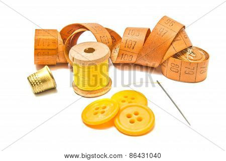 Thimble, Yellow Buttons And Spool Of Thread