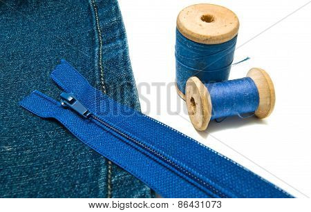 Denim With Blue Zipper And Spools Of Thread