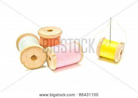 Four Spools Of Thread With Needle