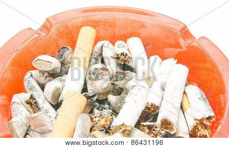 Many Butts In Red Ashtray