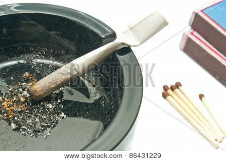 Cigarette In Ashtray With Matches