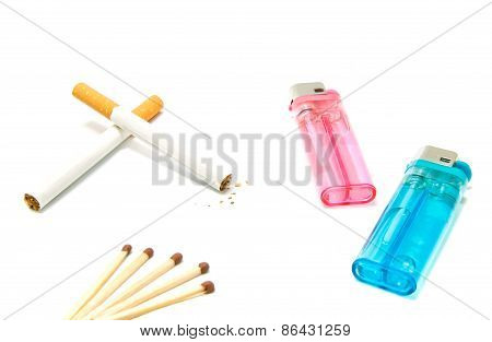 Cigarettes And Two Lighters With Matches