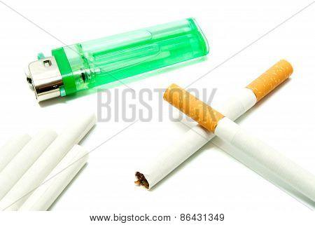 Few Cigarettes And Green Plastic Lighter