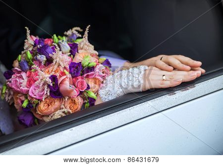 Wedding Rings On The Hands Of The Bride And Groom