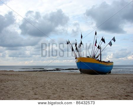 Fishing boat on the Balitc sea shore