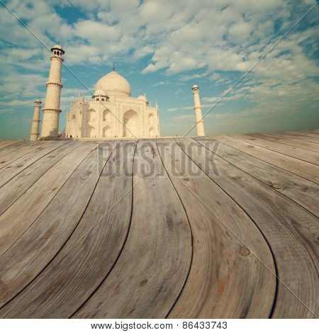 Taj Mahal India Sunset view from wooden platform.