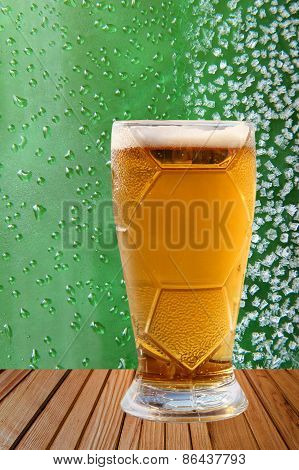Frost Beer Glass Against Of Green Drips And Ice Crystals.