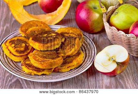 Fritters With Pumpkin And Apples On A Beige Plate