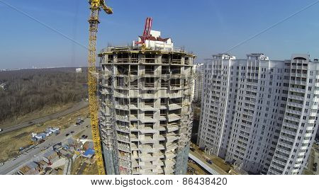 MOSCOW, RUSSIA - MAR 25, 2014: Builders work at construction site of Bogorodskoe. Aerial view