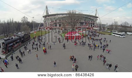 MOSCOW, RUSSIA - MAR 30, 2014: Lot of people walk away from Locomotive sports stadium after football match at spring day. Aerial view.