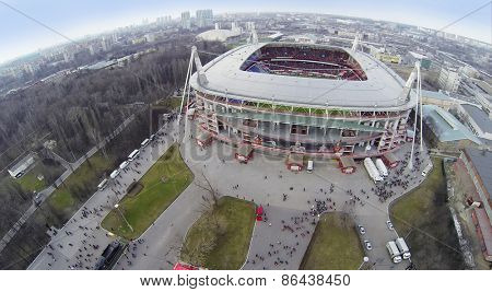 MOSCOW, RUSSIA - MAR 30, 2014: Cityscape with people on tribunes of Locomotive sports stadium at spring day. Aerial view