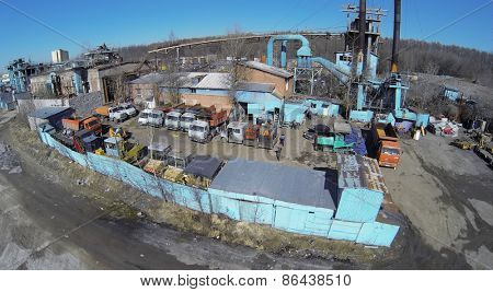 MOSCOW, RUSSIA - MAR 27, 2014: Aerial view of row lorries on the parking near industrial building.