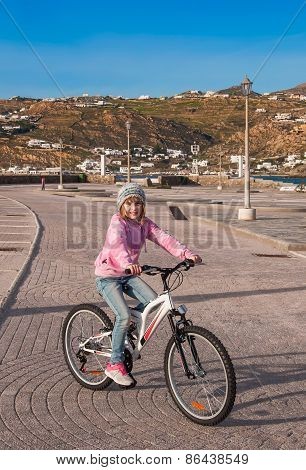 A  Girl Riding Her Bicycle In Spring.
