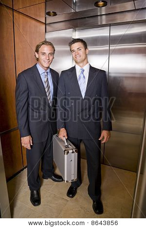 Businessmen Standing In Elevator