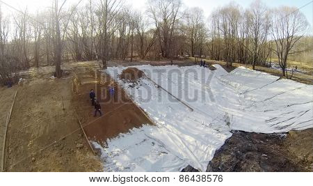 MOSCOW, RUSSIA - FEB 28, 2014: Aerial view to the staying workers on a bottom of pit.