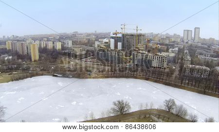 MOSCOW, RUSSIA - MAR 02, 2014: Aerial view of the new high buildings at Vinogradnyi complex and frozen reservoir.