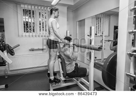 The coach with the client in the gym.