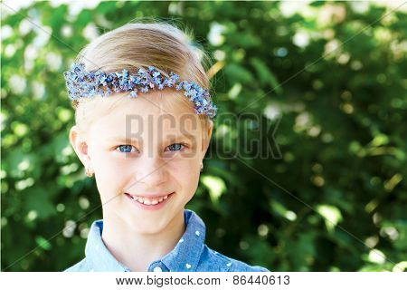 Blonde Smiling Girl Is In A Wreath Of Blue Forget-me