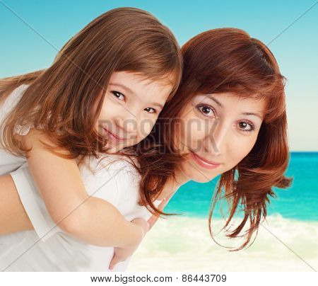 Mother with daughter on beach. Family vacation