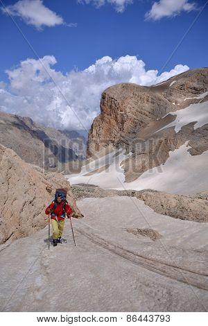 Woman Climbs a  Mountain
