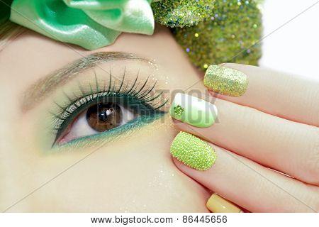 Green makeup and nail Polish.
