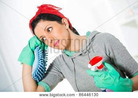Tired frustrated and exhausted cleaning woman