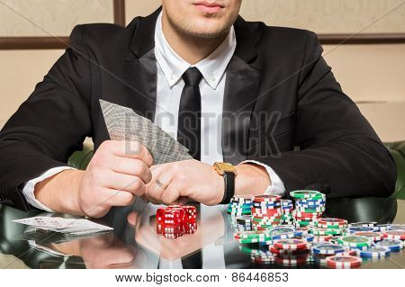 Young guy in the casino at the gaming table.
