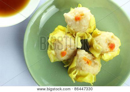 Shumai , Siu Mai - Chinese Steamed Pork Dumplings With Sauce On White Background