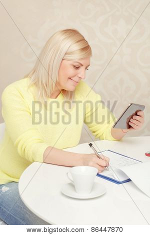Woman watching at her tablet device