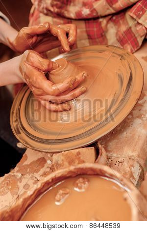 Shaping cay on pottery wheel