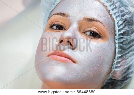 Beautician performs cosmetic procedures.