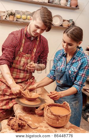 Couple works with clay
