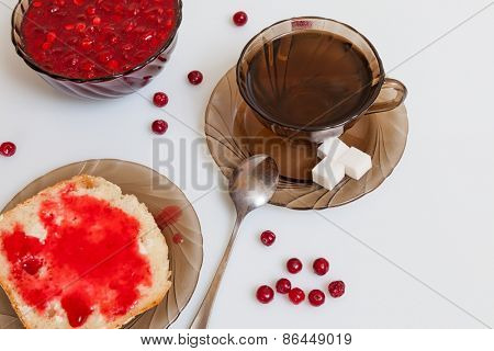 Still life with tea and cranberry