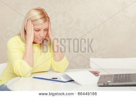 Woman works with papers at home