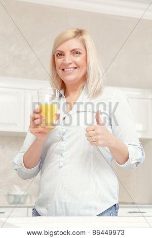 Woman drinks orange juice
