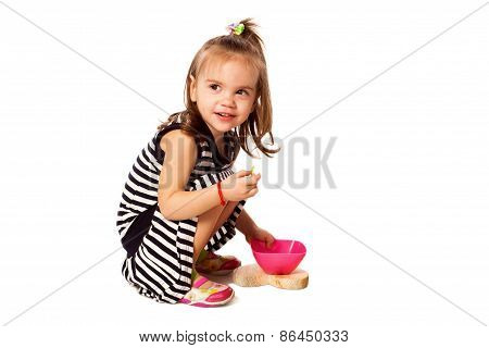 Small Girl Eat Corn Flakes Isolated On White