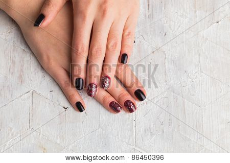 Beautiful female hands with nails painted nails.
