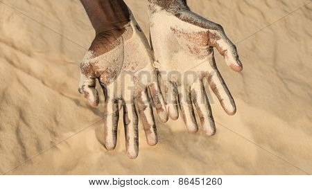 Man holding some sand in the hands