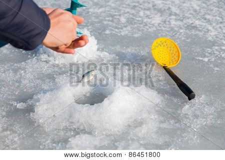 Winter fishing. Ice fishing.