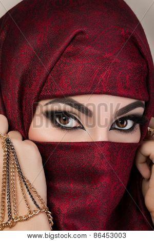 Portrait Of Beautiful Arabian Girl Hiding Her Face
