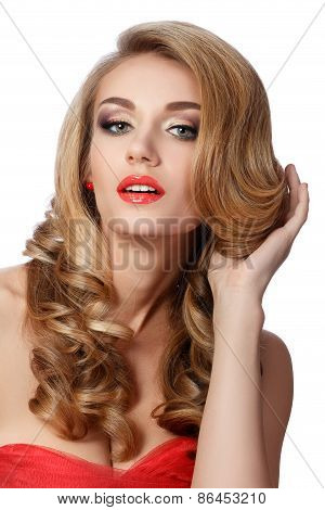 Portrait Of Beautiful Woman In Red Dress Doing Up Her Hair