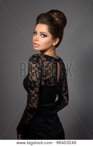 Beautiful Young Model In Black Dress Standing Back To Camera