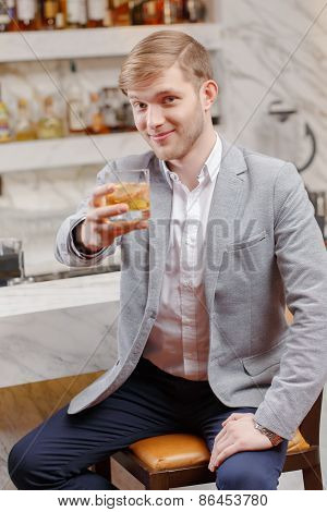 Man with a cocktail in the bar