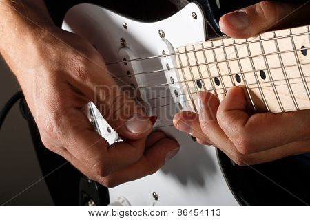 Hands Of Man Playing Electric Guitar Closeup